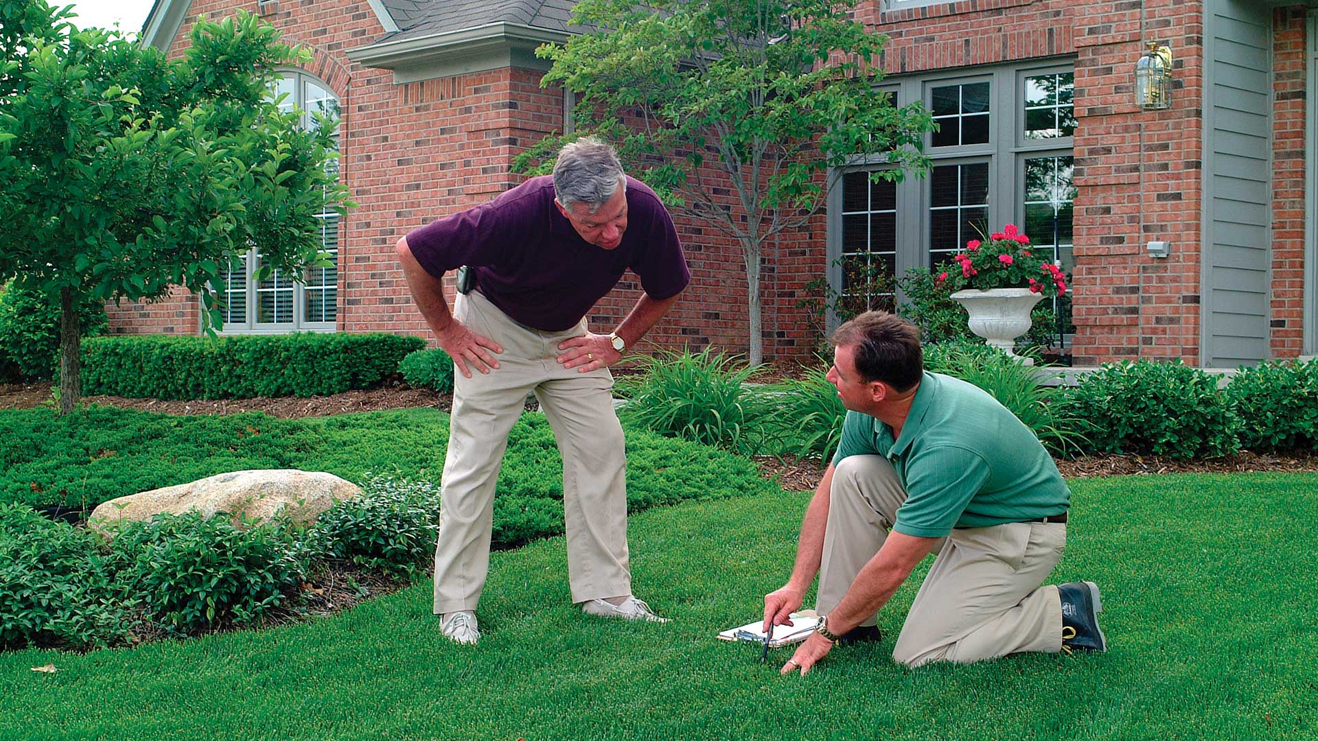 1.888.LawnTec discussing a lawn treatment program with a customer in Berkeley Heights, NJ.
